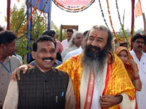 Jharkhand Chief Minister Madhu Kodaji with Acharya Pramod Krishnamji._2
