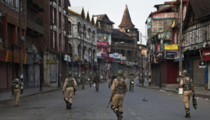 Indian paramilitary soldiers patrol a deserted street during curfew in Srinagar, Indian controlled Kashmir, Tuesday, Sept. 13, 2016. Security forces fired tear gas and shotgun pellets to quell protesters in several places, as a security lockdown marred Eid festivities in the troubled region. Shops and businesses were closed, with a curfew in effect in the entire Kashmir Valley. (AP Photo/Dar Yasin)